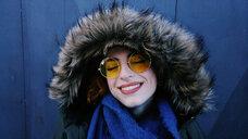Head shot of young woman wearing sunglasses - INGF01172