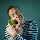 Studio shot of a man hugging a cactus plant - INGF01232