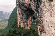 Sport climbing on limestone on Moon Hill, Yangshuo, Guangxi, China - CUF46305