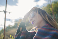 Young woman on a hiking trip wearing sunglasses - AFVF01784