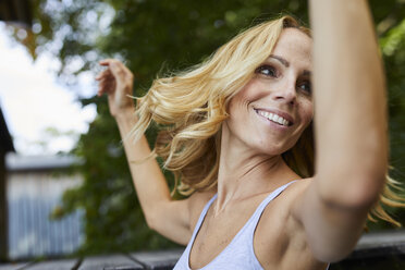 Carefree blond woman outdoors - PNEF01076