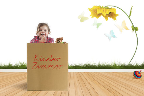Little girl playing in a cardboard box in her children's room - KLR00711