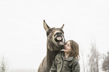 Playful girl and donkey - FSIF03380