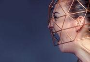 Closeup of a woman screaming inside a metallic structure - INGF01593