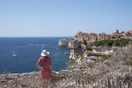Corsica, Bonifacio, woman standing on viewpoint looking to the city - HAMF00468