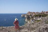 Corsica, Bonifacio, woman standing on viewpoint looking to the city - HAMF00468