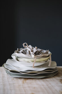 Stcked plates and cutlery on a brunch buffet - ALBF00635