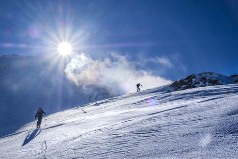 Two men doing a ski tour in Faragas mountains, Southern Carpathians, Romania - HAMF00500
