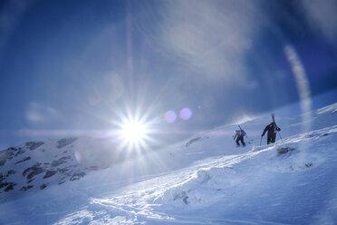 Two men doing a ski tour in Faragas mountains, Southern Carpathians, Romania - HAMF00506