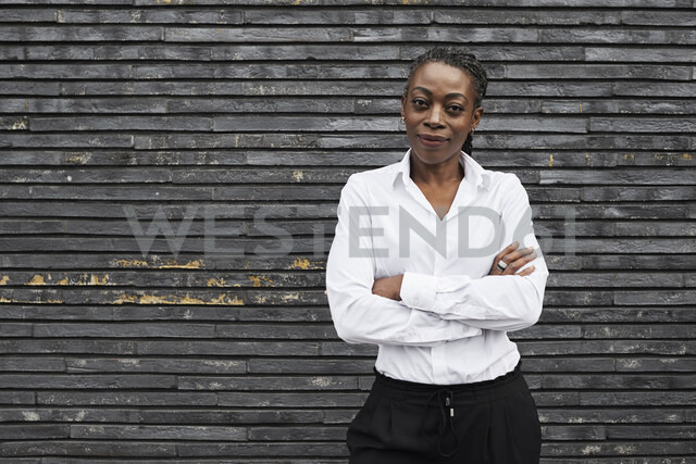Portrait of smiling businesswoman  wearing white shirt - IGGF00663