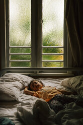 Baby girl sleeping on bed early in the morning - GEMF02422