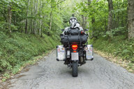 Father and son on a motorbike trip on a country road - FBAF00130