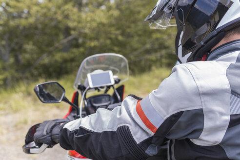 Man on a motorbike trip - FBAF00142