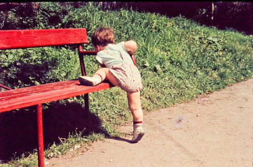 Little boy trying to get up on bench - INGF01887