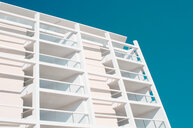 Low angle view of white architectural buildings against on a sunny day - INGF02058