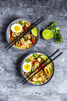 Ramen soup with egg, noodles, chicken meat, paprika, mushroom, spring onion, lime and coriander - SARF03948