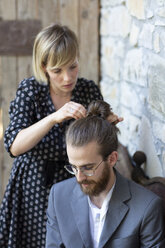 Woman doing hair of young man in grey suit - ALBF00672
