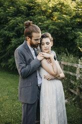 Bride embracing groom on a meadow - ALBF00675