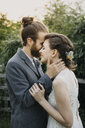 Happy affectionate bride and groom outdoors - ALBF00678