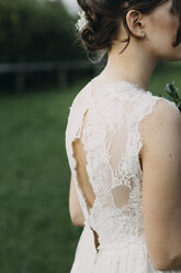 Close-up of young woman wearing wedding dress outdoors - ALBF00681