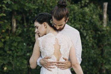 Bride and groom embracing outdoors - ALBF00690