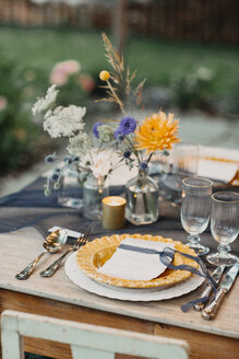 Place setting on festive laid table outdoors - ALBF00699