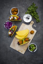 Sweet potato falafel in taco shells, with red cabbage, salad, carrot, yogurt sauce and black sesame - LVF07476