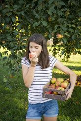 Girl eating freshly harvested apple - LVF07483