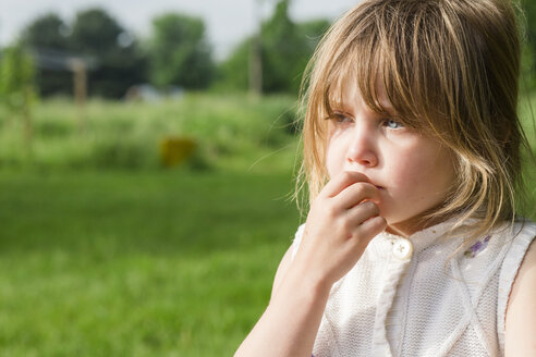 Close-up of cute thoughtful girl looking away at farm - CAVF49822