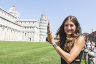Italy, Pisa, portrait of young woman posing with the Leaning Tower in background - WPEF00917