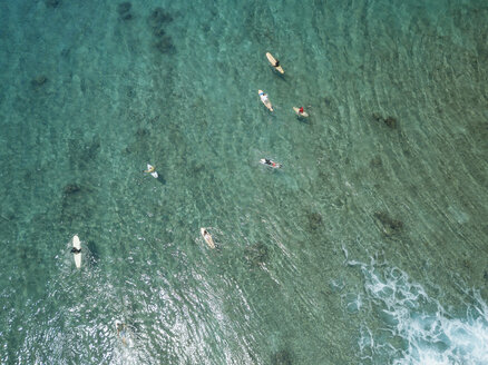 Aerial view of people surfing on sea at Maldives - CAVF50167