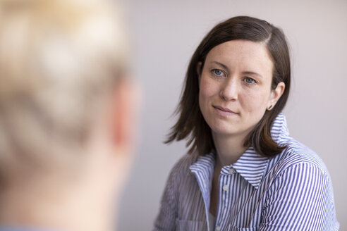 Female doctor talking to patient in medical clinic - CAVF50215