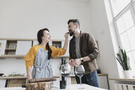 Couple in love having fun together in the kitchen - KMKF00577