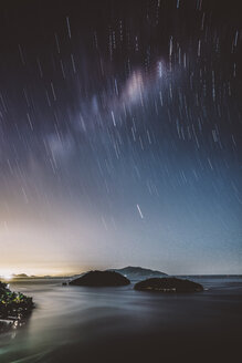 Scenic view of sea against star trails at night - CAVF50349