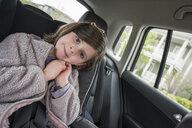 Portrait of cute girl sitting in car - CAVF50391