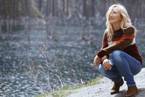 Kazakhstan, Almaty, smiling blond woman at the Lake Kaindy - AZF00111