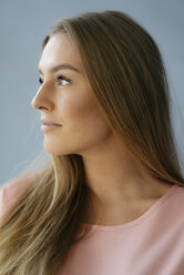 Portrait of young woman looking up - KNSF05001