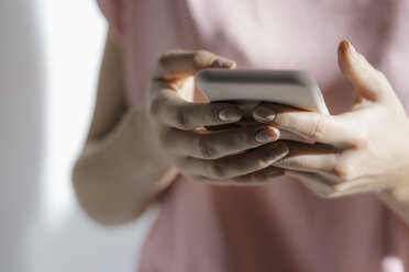 Hands of young woman text messaging, close-up - KNSF05031