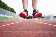 Feet of a jumping runner, mid air - GIOF04791