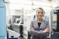 Portrait of confident woman in factory shop floor - DIGF05311