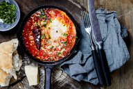 Eggs in Purgatory, eggs, baked in very spicy tomato sauce, sprinkled with parsley and parmegiano - SBDF03788