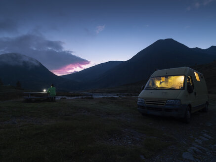 Italy, Lombardy, Laghetto Vivione, camper at night - LAF02110