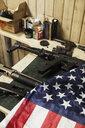Rifles, guns and American flag on table - KKAF02613