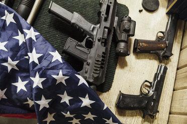 Rifles, guns and American flag on table - KKAF02616