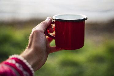 Hand holding coffee cup - KKA02787