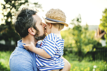 Father kissing his little son - HAPF02793
