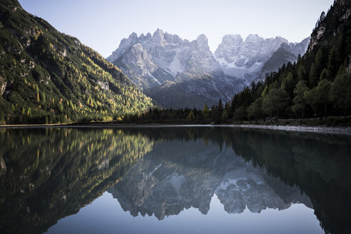 Scenic view of calm lake amidst mountains against sky - CAVF50786