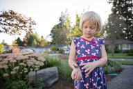 Girl with butterfly standing by plants against sky at park - CAVF50798