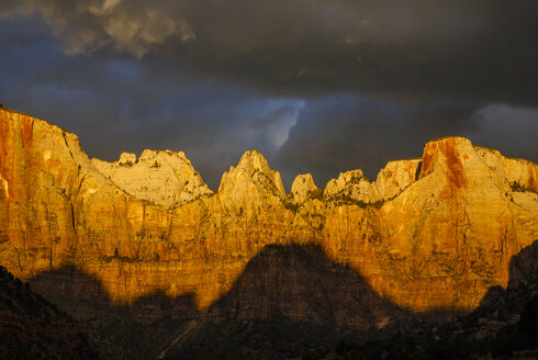Low angle idyllic view of mountain ranges against stormy clouds at Zion National Park - CAVF50861