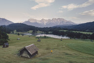 Scenic view of lake and landscape against sky - CAVF50879